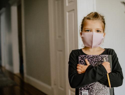 girl-masked-holding-sketch-book