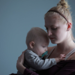 sad-young-mother-with-baby
