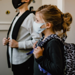 two-children-ready-for-school-with-masks