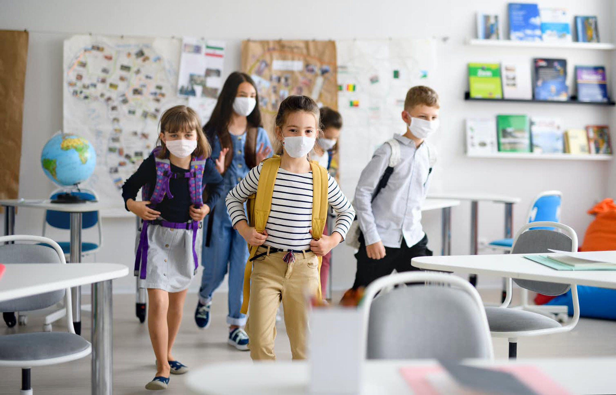 school-kids-entering-classroom-with-masks