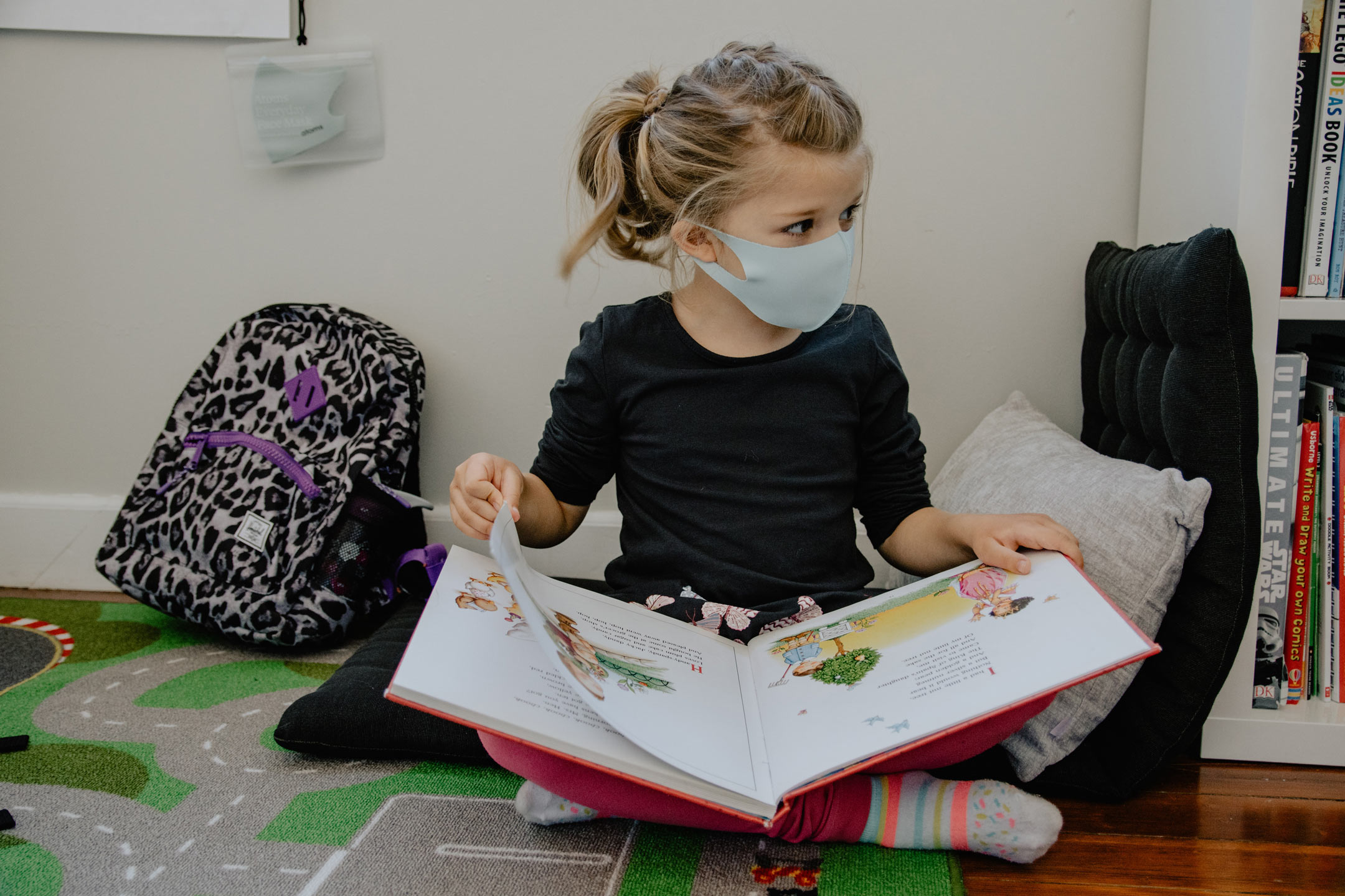 young-school-girl-reading-with-mask-on-2160