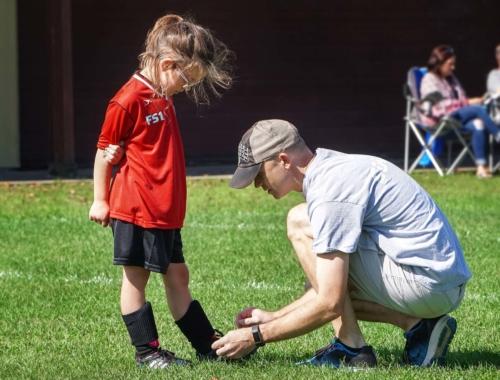 soccer-girl-man-typing-shoelaces2160